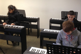 Junior piano players.