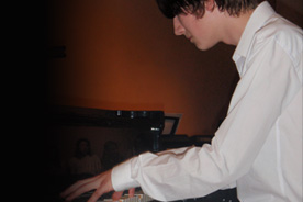 Young boy playing piano.