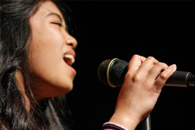 Young girl singing.
